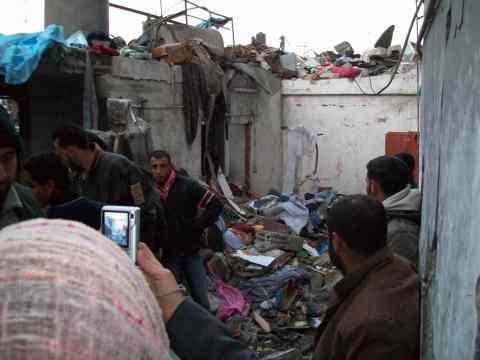 E documents rubble of Belusha home