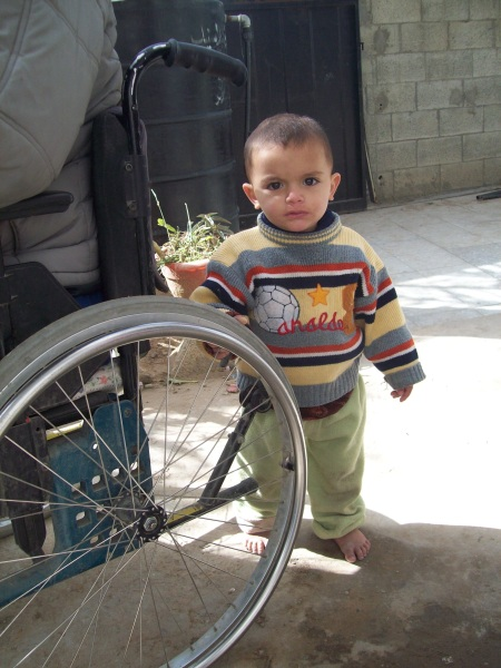 Baby A, out of the basement, with his uncle who lost both legs in past attack