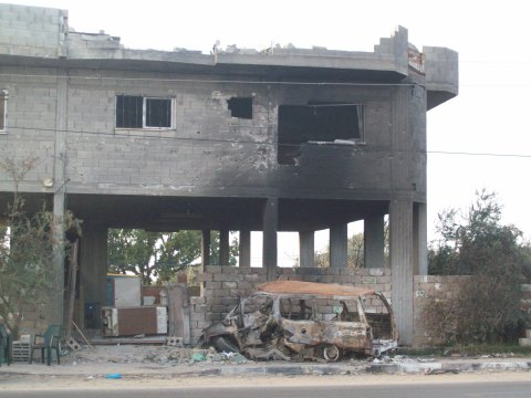 Shelled Al Helou house and shelled delivery van