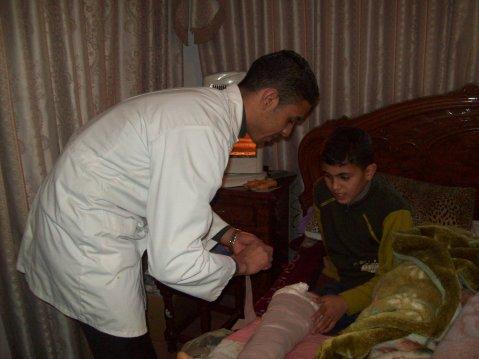 Firas with volunteer nurse Mohammed