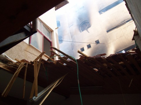 Roof destroyed by strike, fire continues in Red Crescent Operations next door