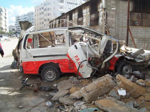 Destroyed ambulance beside park-up compound
