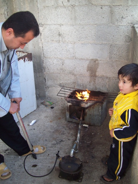 Medic Hassan with his amazing stove & son Fawzi