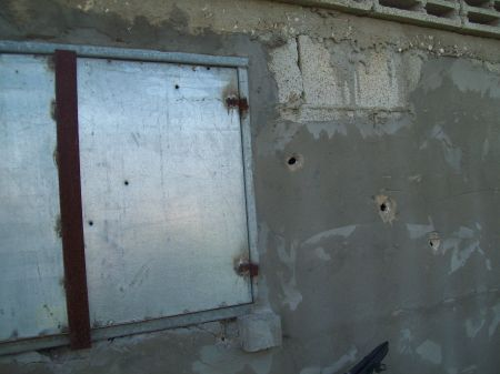 Behind these bullet holes is the kitchen, Dec/Jan attacks