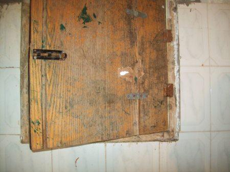 Bullet holes through bathroom shutter