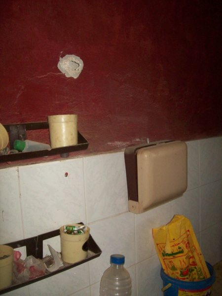 Bullet strikes to kitchen wall, Dec/Jan attacks