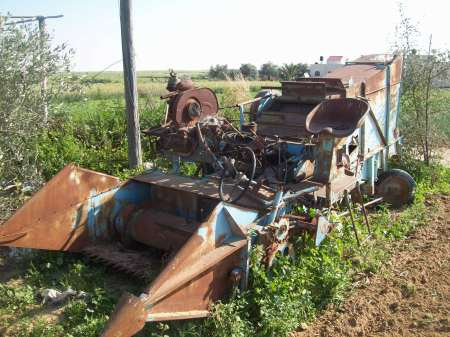 Wheat picker broken by tanks May 08