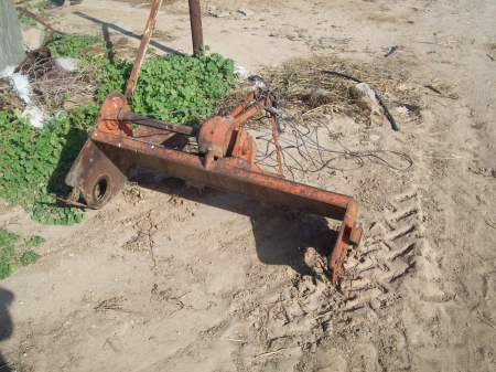Piece of tractor destroyed by tanks May 08