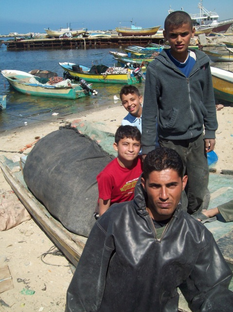 Abd Abel Aziiz with his small boat behind him